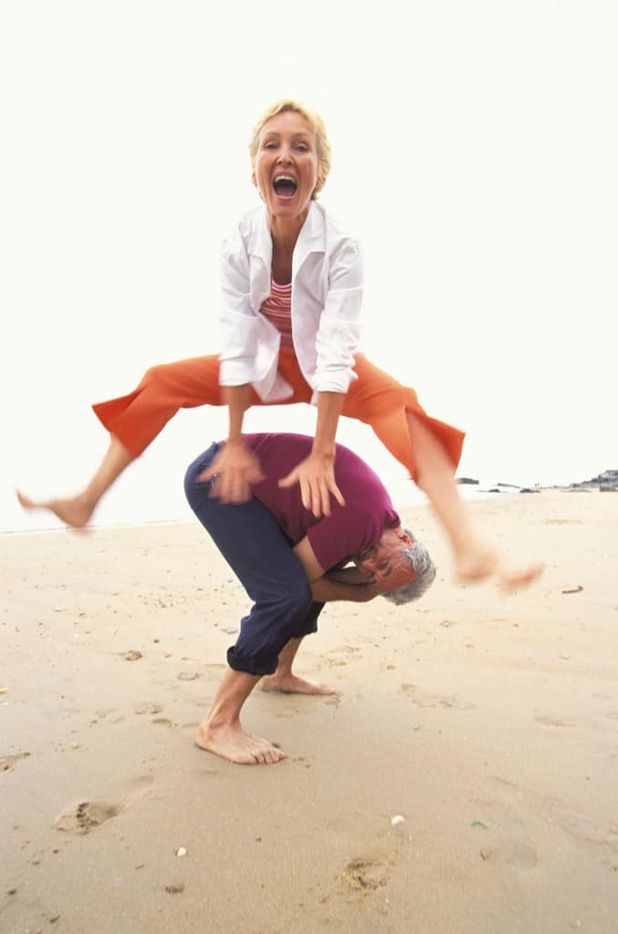 PageLines- twoseniors-jumping-beach.JPG
